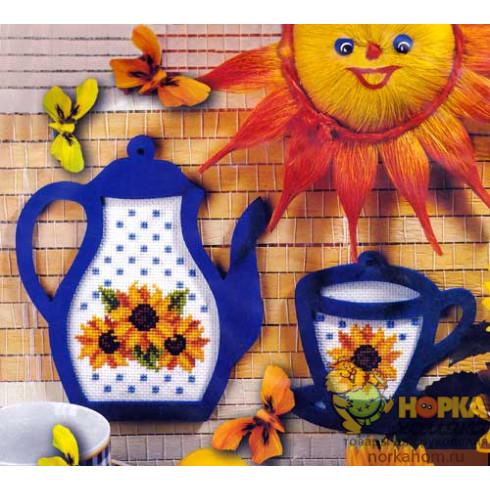 Чайник и чашка с подсолнухами